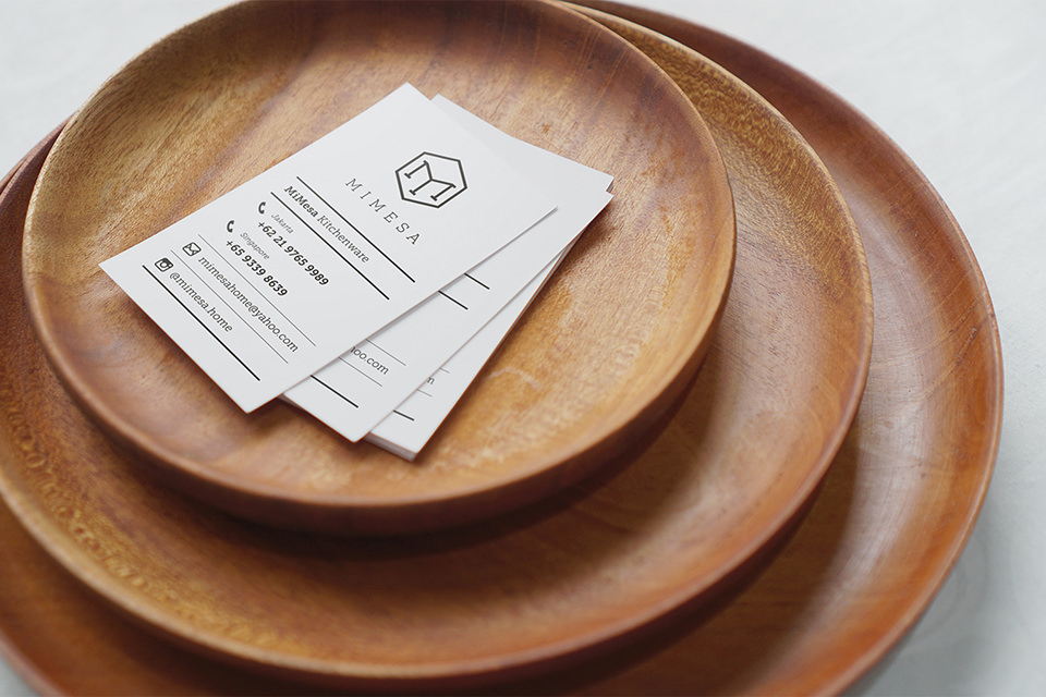 Mimesa business card on top of mimesa wooden plate